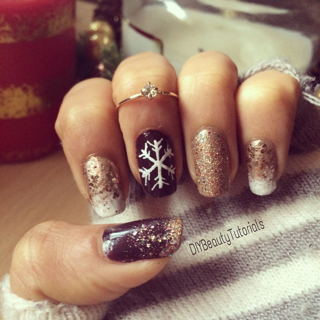 Christmas and New Year Nail art with gold glitter and snowflakes